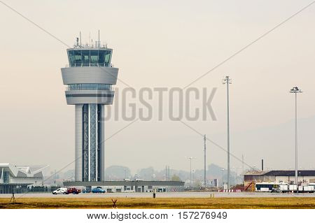 Sofia, Bulgaria - October 16, 2016: Airport control tower at Sofia's airport in a foggy weather.