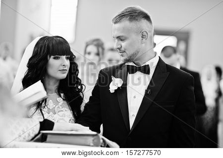 Wedding Couple Swear One To One With Hands On Gospel At Church. Black And White Photo