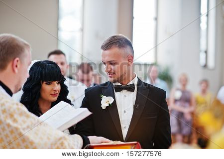 Wedding Couple Swear One To One With Hands On Gospel At Church.