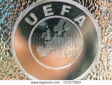 London, the UK - May 2016: UEFA emblem at Stamford Bridge museum