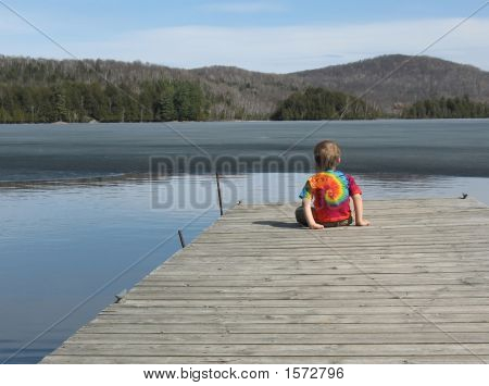 Little Boy At Lake In Spring