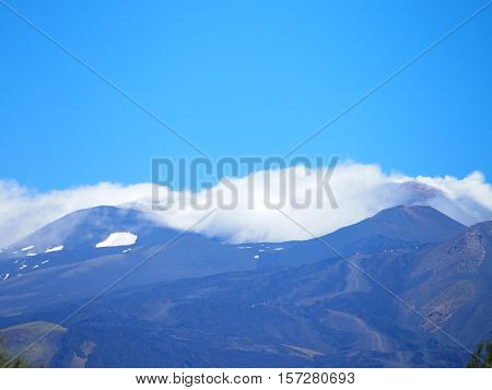 Fuming Etna in spring, the tallest active volcano in Europe, Sicily, Italy