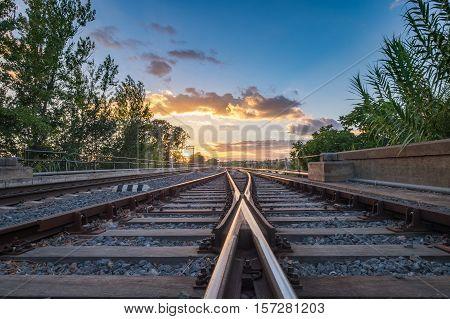 Railroad sunset over the bridge in Aljucen River