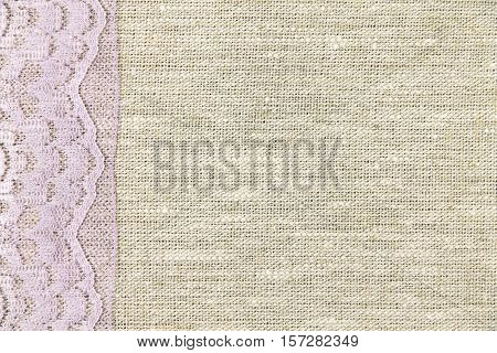 lilac lace on a gray fabric background