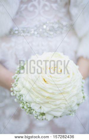 Bride holding Biedermeier Bouquet on a Wedding Day