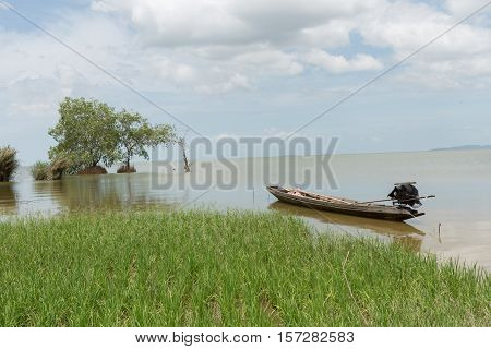 lone row boat on lake in south thailand