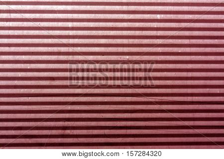 Corrugated Red Toned Metal Plate Surface.