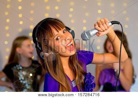 Group Of Happy Girls Singing On Karaoke
