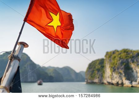 The Flag Of Vietnam Fluttering On Ship In The Ha Long Bay