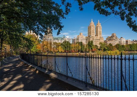 Upper West Side with colorful fall foliage across Jacqueline Kennedy Onassis Reservoir. Central Park West. Manhattan, New York City