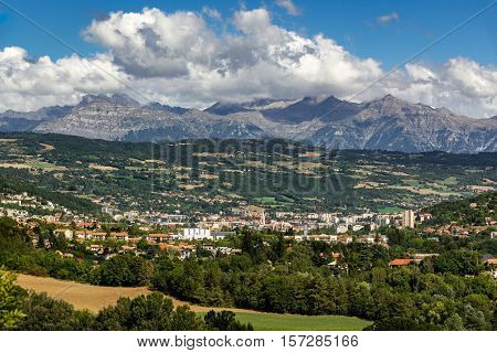 The city of Gap in the Hautes Alpes with surrounding mountains and peaks in Summer. Southern French Alps, France