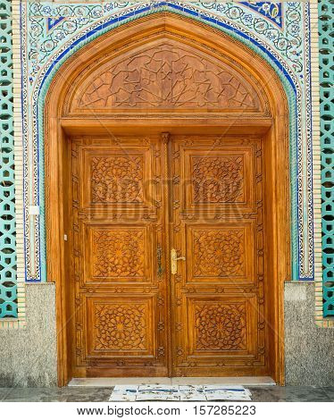 Old wooden door to the mosque hand-crafted. Ali bin Abi Taleb Mosque in old city Deira Dubai. The creek is divides the city into two main sections Deira and Bur Dubai old downtown of Dubai.