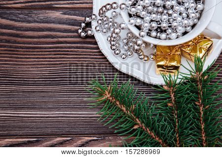Cup of tea with christmas gifts.Top view, on a wooden background