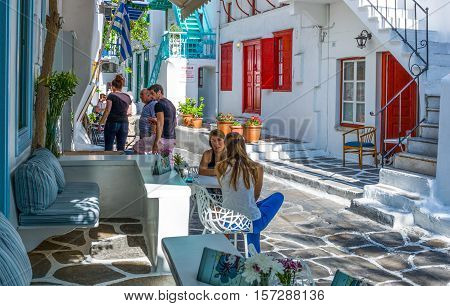 Mykonos Greece - October 15 2012: People in an alley of the Chora village