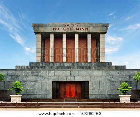The Ho Chi Minh Mausoleum in centre of the Ba Dinh Square in Hanoi Vietnam. Blue sky in background. The Ho Chi Minh Mausoleum is a popular tourist destination of Asia.