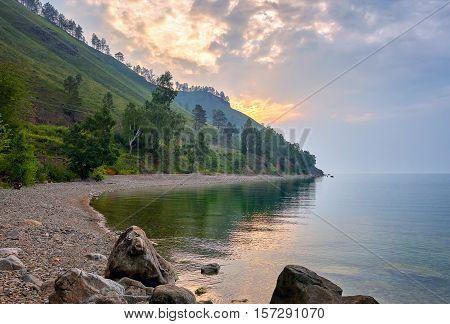 Overcast morning on bay. Lake Baikal. Irkutsk region. Russia poster