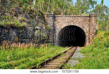 Facade of one of many tunnels on Circum-Baikal Railway. Architecture of early 20th century. Irkutsk region. Russia