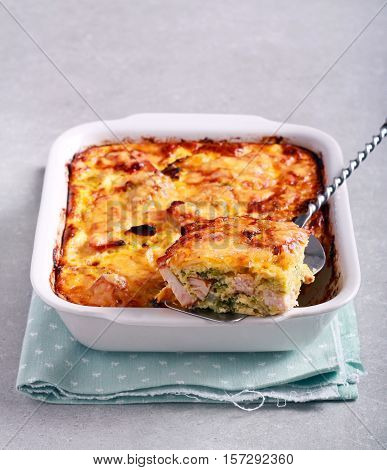 Savoy cabbage and chicken gratin in a tin