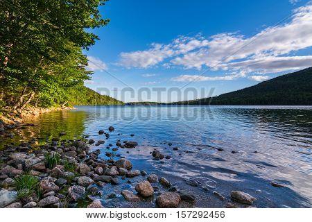 Jordan Pond at Acadia National Park. Daytime Rocky shore