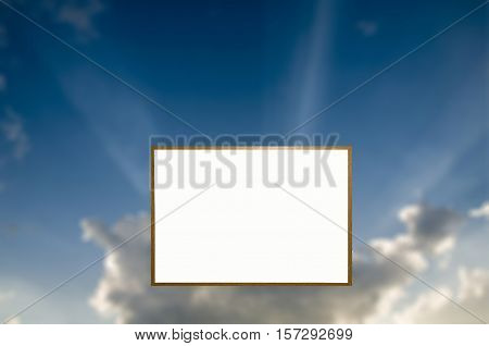 Framed White board for text over a partly cloudy sky with sun bursts