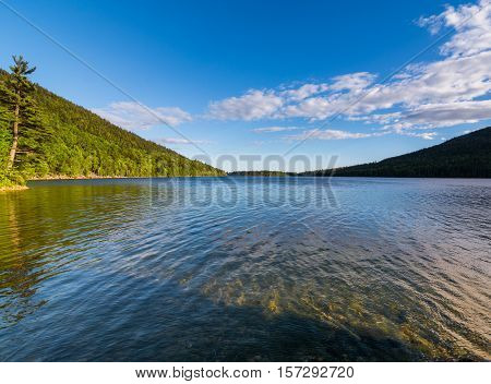 Jordan Pond at Acadia National Park. Daytime with clear skies and partly still waters