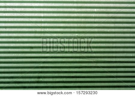 Corrugated Green Metal Plate Surface.