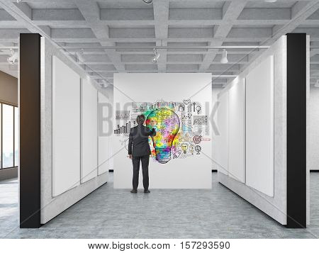 Rear view of a businessman drawing a large colorful light bulb sketch in an art gallery. Concept of a brilliant idea. 3d rendering. Mock up