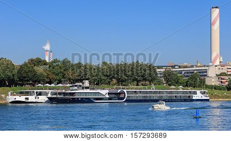 Basel, Switzerland - 27 August, 2016: passenger ships at a pier on the Rhine river. Basel is a city on the Rhine river in northwestern Switzerland, situated where the Swiss, German and French borders meet.