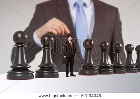 Close up of a man playing chess. One of the pawns is a businessman. Concept of strategy and management
