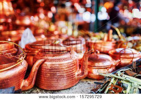Vintage Copper Tea Kettles At Market In Lijiang, China