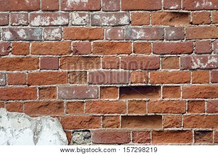 Red Clay Brick Wall Old Texture. Grungy Brickwall Horizontal Background. Vintage Brickwork Backdrop. Red Stonewall Surface. Broken Retro Wall Structure. Retro Grungy Brown Wall. Damaged Building Facade Close-up