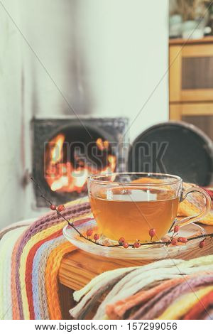 Cup Of Tea And Flames Of Fire In A Fireplace