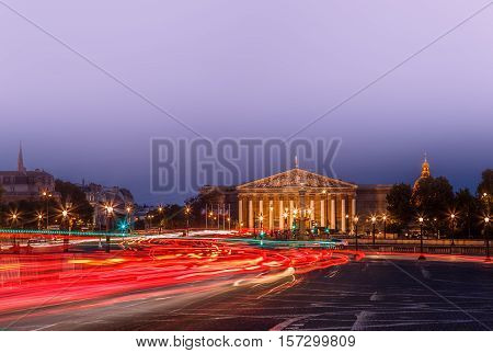 The Bourbon Palace is the place where National Assembly meets. It located on the left bank of the Seine, across from the Place de la Concorde. Paris cityscape night view,