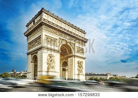 Arc de triomphe, Paris, France, at the blue sky background. One of rhe symbol landmark of Paris city.