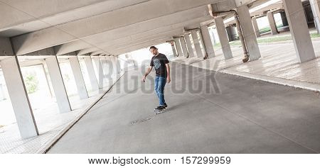 Professional Skateboarder In Underground Passage