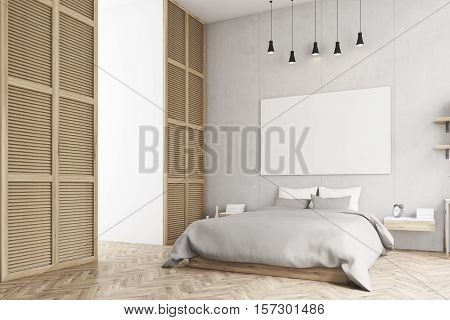 Side view of a bedroom interior with king size bed bedside table and a large window in a beige wall. Horizontal poster is hanging above the bed. 3d rendering. Mock up.
