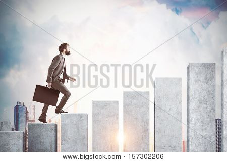 Side view of a man climbing the concrete stairs made in the shape of a graph. Cloudy sky and city are in the background. Concept of success and achieving your goal. Mock up. Toned image