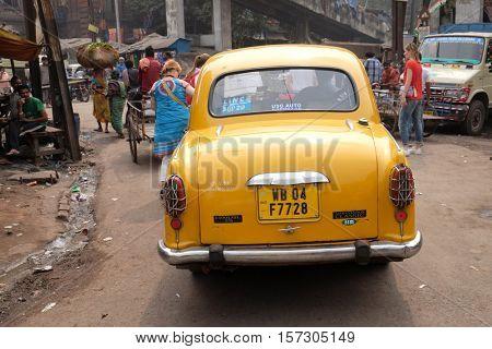 KOLKATA, INDIA - FEBRUARY 10: The classical ambassador cab is the unique style of taxi service that imported from British civilization, Kolkata, India on February 10, 2016.