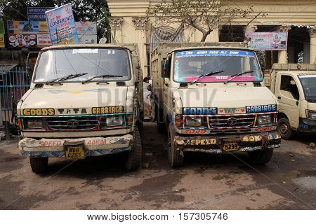 KOLKATA, INDIA - FEBRUARY 10: Trucks wait  for a new cargo nearby Kolkata Flower Market. Using trucks is the most common way of transporting cargo in India. Kolkata, India on February 10, 2016.
