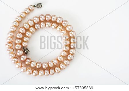 Pearl Necklace on white background. Studio Photo