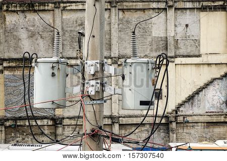 Old Reinforced Concrete Pole With Electrical Wires
