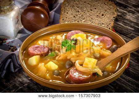 Jota- traditional slovenian food on wooden background