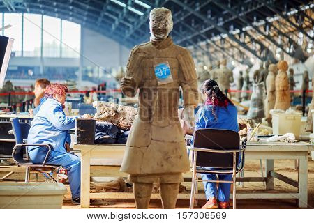 Archaeologists Working At Excavation Of The Terracotta Army