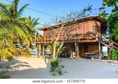 Wooden house on Caribbean beach in Belize, Central America