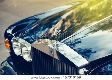 PARIS FRANCE - SEP 12 2016: Exclusive Luxury Rolls-Royce car limousine parked in city during fashion wedding vip event waiting for passenger. Rolls-Royce Limited is a British car-manufacturing and later aero-engine manufacturing company founded by Charles