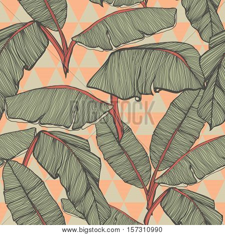 Tropical palm leaves seamless background in vector