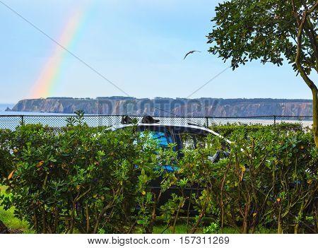 Rainbow Over Sea Coast.