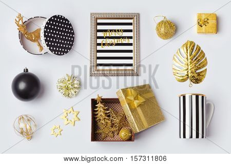 Christmas decorations ornaments and objects in black and gold for mock up template design.View from above. Flat lay