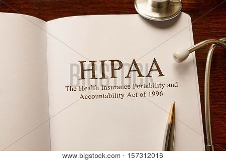 Page with HIPAA The Health Insurance Portability and Accountability Act of 1996 on the table with stethoscope medical concept