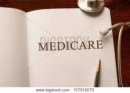 Page with Medicare on the table with stethoscope medical concept